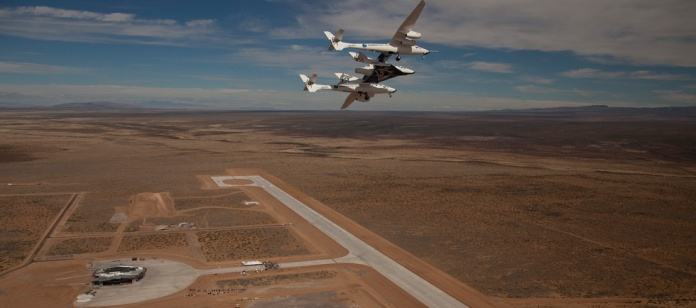 WhiteKnightTwo mothership cradles SpaceShipTwo over New Mexico's Spaceport America