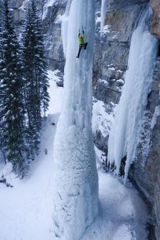 Ice climbing a frozen waterfall