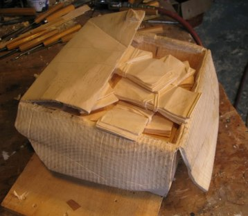 randall-rosenthal-carves-a-block-of-wood-into-a-box-of-money-9