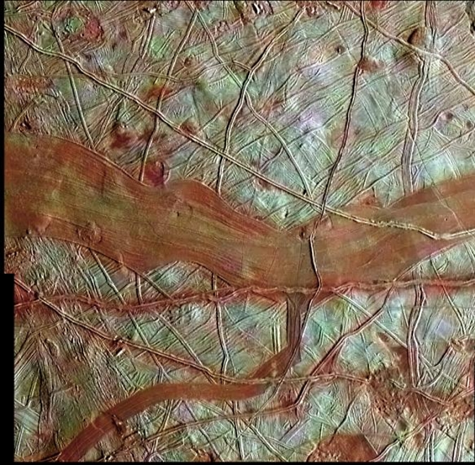 "A ""colorized"" image of Europa from NASA's Galileo spacecraft, whose mission ended in 2003. The whiteish areas are believed to be pure water ice. Credit: NASA/JPL-Caltech/SETI Institute"