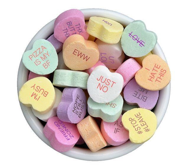 Candy  hearts in a bowl on black